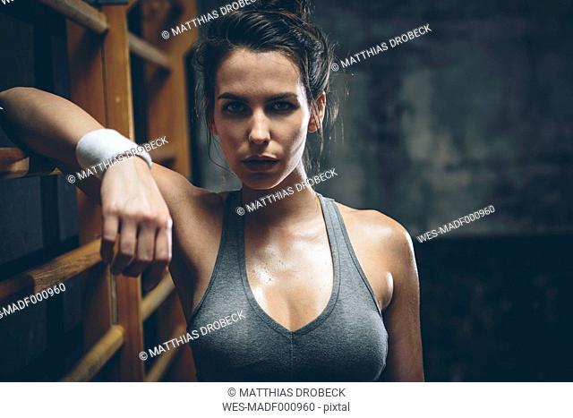 Female athlete on wall bars