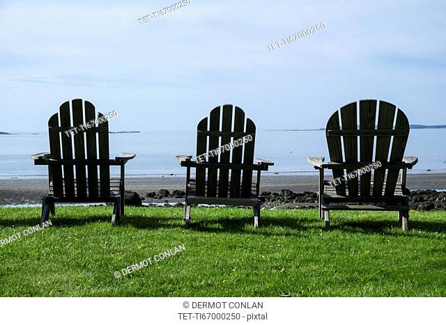 Three adirondack style chairs