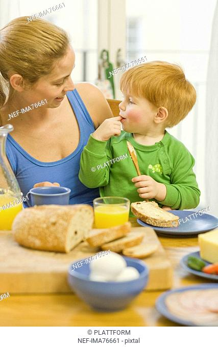 Mother and son having breakfast, Sweden