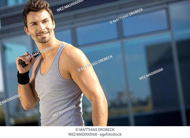 Portrait of smiling sportsman