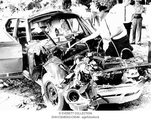 Bomb wrecked remains of car of Jackson County Solicitor, Floyd Hord, who was killed. Jefferson, Georgia, Aug. 7, 1967. The killers were group of bootleggers