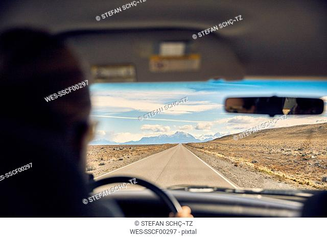 Argentina, Patagonia, El Chalten, woman driving camper on road towards Fitz Roy