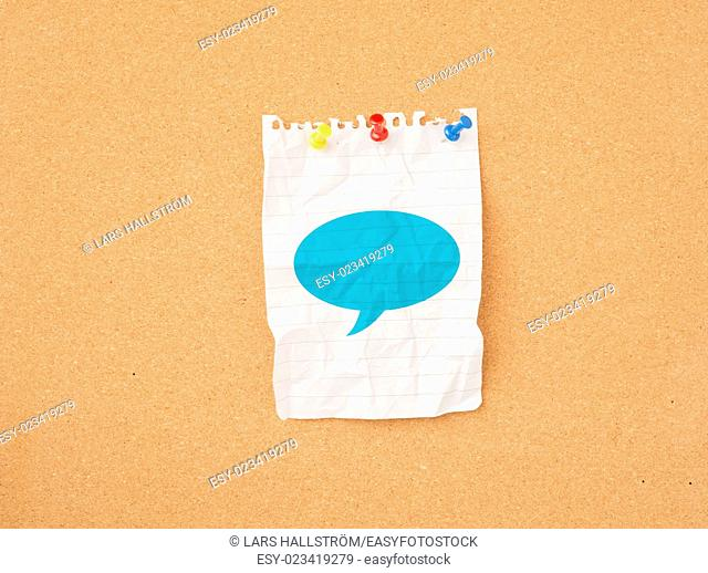 Paper with speech bubble on message board. Concept of conversation, communication and speaking