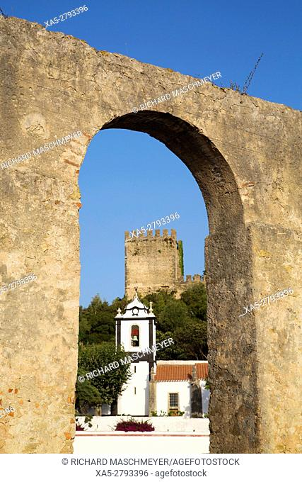 View thru aqueduct of St Peter's Church and Medieval Castle, Obidos, UNESCO World Heritage Site, Portugal