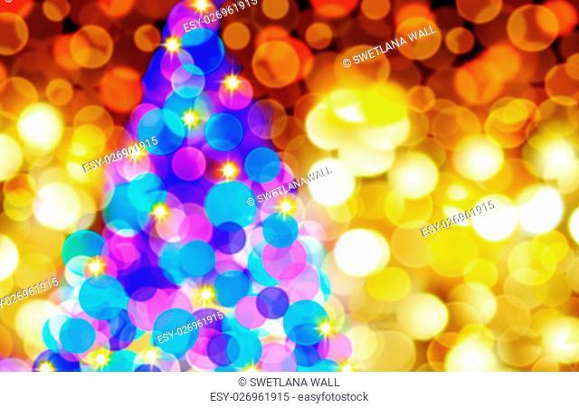 Defocused Bokeh Background Effect. New Year Boke Lights Xmas Christmas Tree And Festive Illumination. Christmas tree lights at night