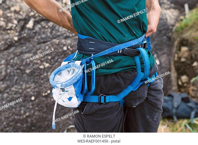 Close-up of magnesium bag and climbing harness