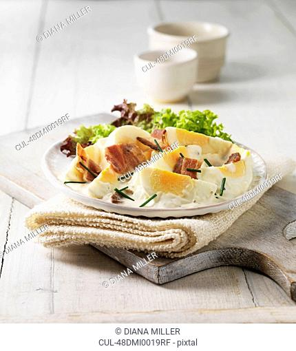 Plate of eggs, bacon and salad