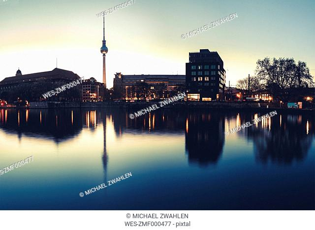 Germany, Berlin, TV Tower, spree river and water reflection in the evening