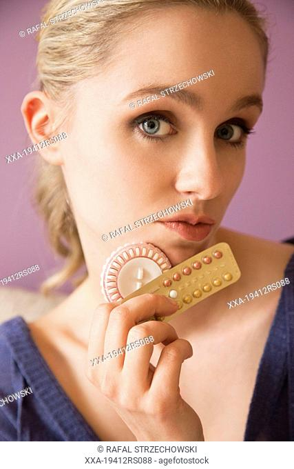 Portrait of a woman with birth control pills