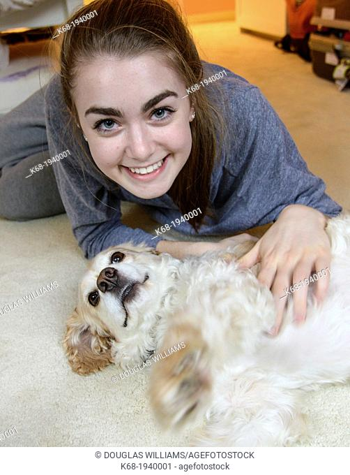 Teenage girl with her dog, a cocker spaniel