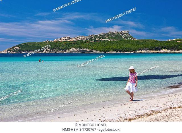 Italy, Sardinia, Province of Olbia-Tempio, Santa Teresa Gallura, Capo Testa, a young woman on a beach
