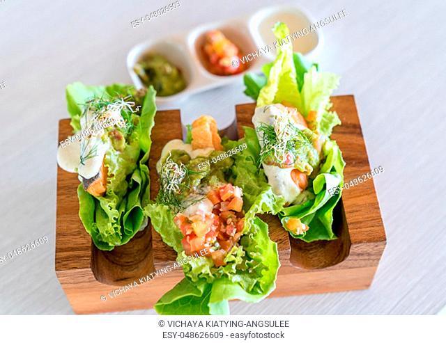 Salmon salad Tacos set groumet mexical style food