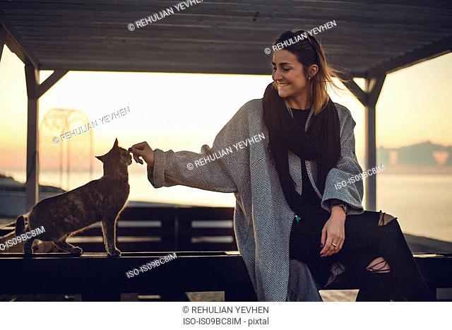 Woman stroking cat, Odessa, Odeska Oblast, Ukraine