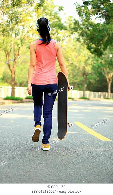 young fitness woman walking