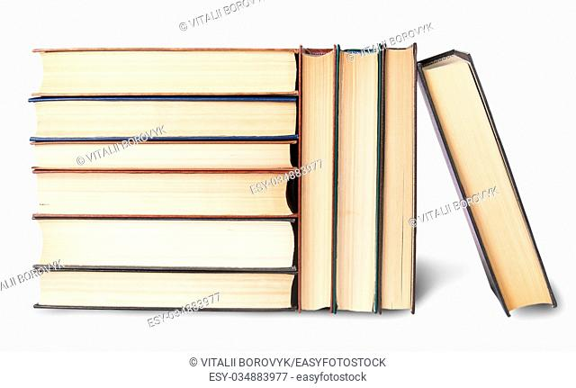 Vertical and horizontal stacks of old books isolated on white background
