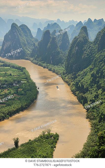 Boat traveling up the scenic Li River, Xingping, Guangxi Autonomous Region, China