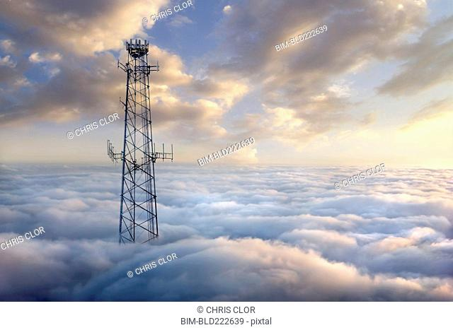 Cellular tower above clouds