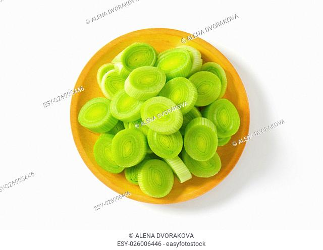 plate of leek slices on white background