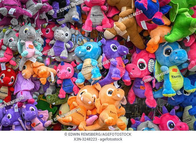 Abundance of plush dragon dolls on street vendor cart, Kraków, Lesser Poland Voivodeship, Poland