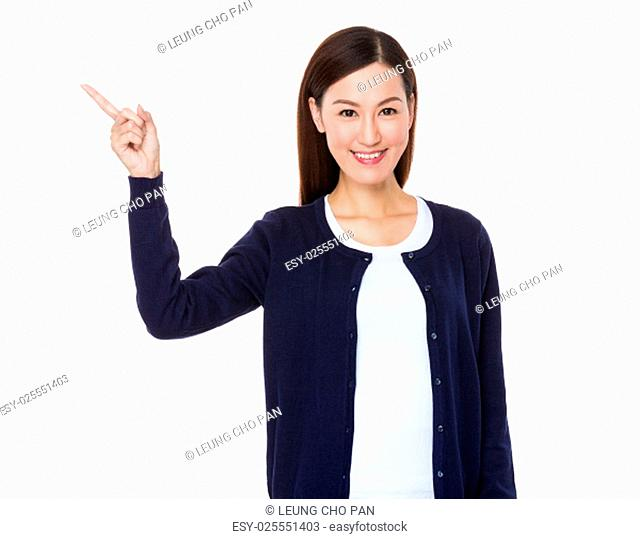 Young woman showing something by finger