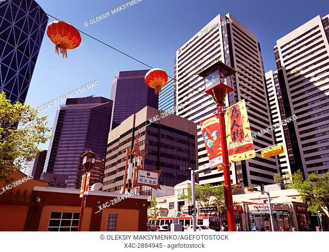 Calgary's Chinatown with it's colorful red Chinese lanterns and oriental decor. Calgary city downtown buildings in the background