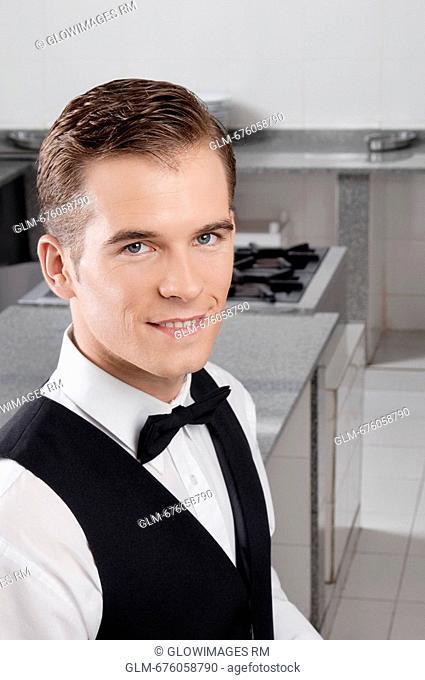 Portrait of a waiter smiling