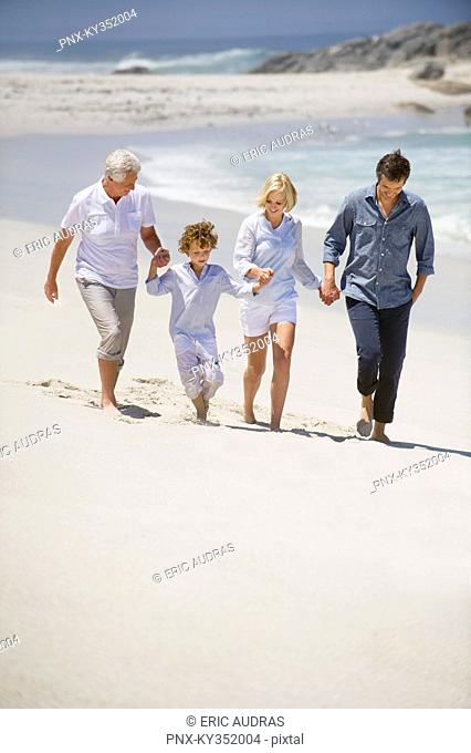Multi generation family walking on the beach