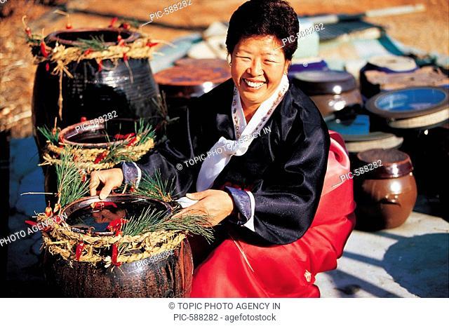 Woman In Korean Costume Making GanjangSoybean Sauce,Korean Food