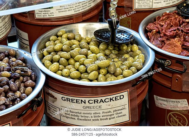 Green Cracked Greecian Olives Displayed and Offered for Sale in a Manhattan, New York City, gourmet food market