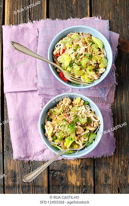 Ground beef fried with celery tahini, chili and pasta