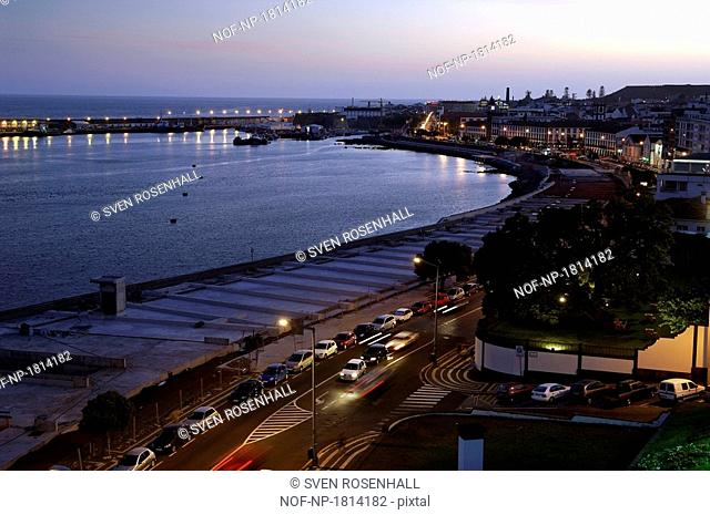 High angle view of a city lit up at dusk, Ponta Delgada, Azores, Portugal