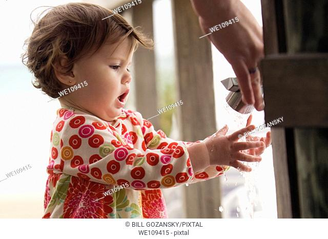 Young child washing hands at faucet near beach - Fort Lauderdale, Florida