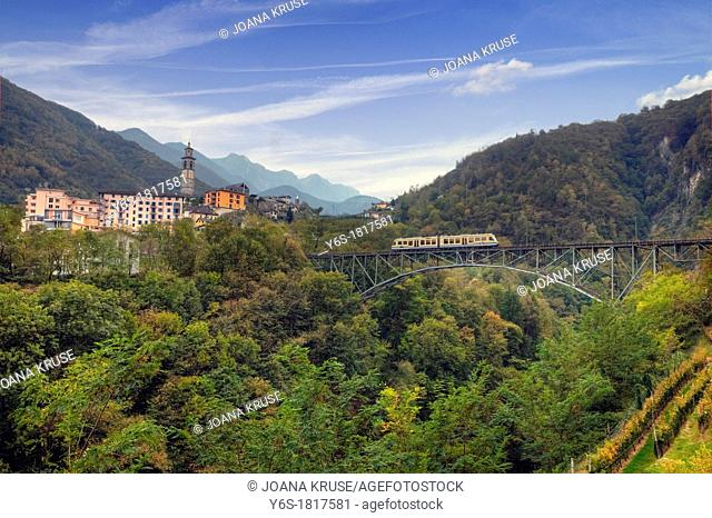 Intragna is the highest with 65 75 m steeple of Ticino, Switzerland  The narrow gauge railway Centovalli crosses with a 82m high viaduct river Isorno