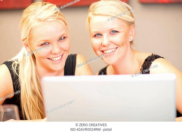 Twin businesswomen working together