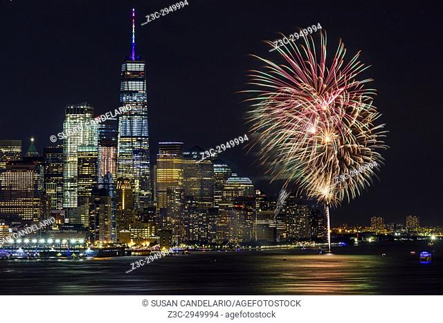 NYC World Trade Center Pride - View to the fireworks display celebration on the Hudson River by the WTC in lower Manhattan