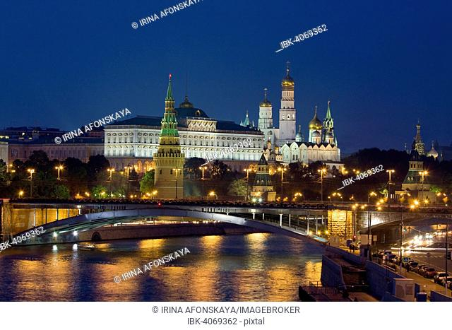 Moscow Kremlin with cathedrals and palace and Bolshoy Kamenny Bridge on Moskva River at night, Moscow, Russia