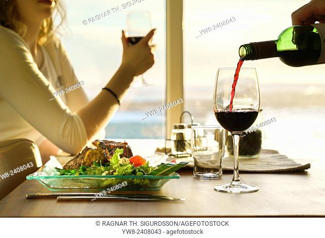 Drinking red wine with dinner, Iceland