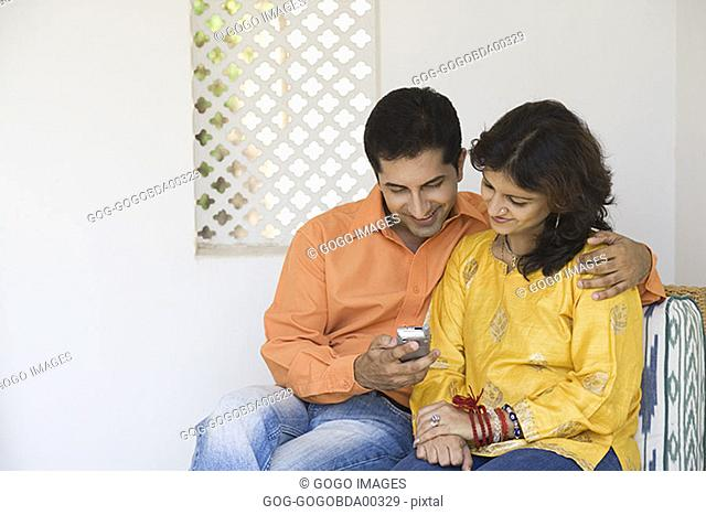 Couple using a cell phone