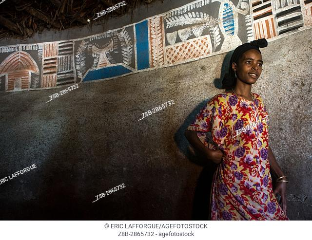 Ethiopian woman inside her traditional painted and decorated house, Kembata, Alaba Kuito, Ethiopia