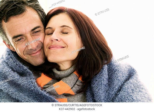 40-45 year old Caucasian couple keeping warm