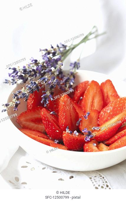 Strawberries with lavender syrup and lavender flowers