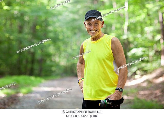 Man resting during exercise, portrait