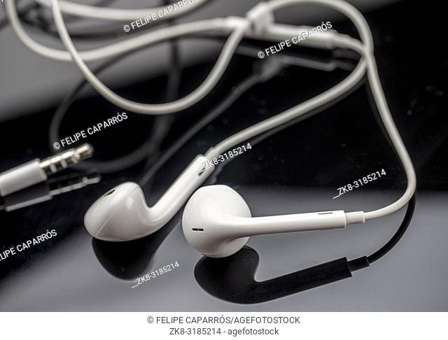 White headphones isolated on black background, conceptual image
