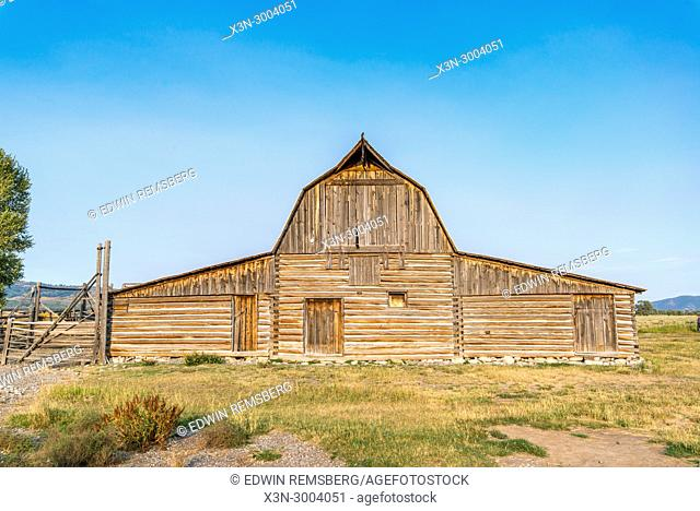 Famous Moulton Barn stands against clear blue skies, Grand Tetons National Park