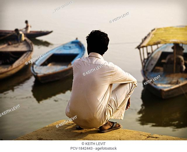 The Ganges,Varanasi,India,Rear view of a man at water's edge