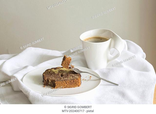 Close-up of marble cake slice with coffee