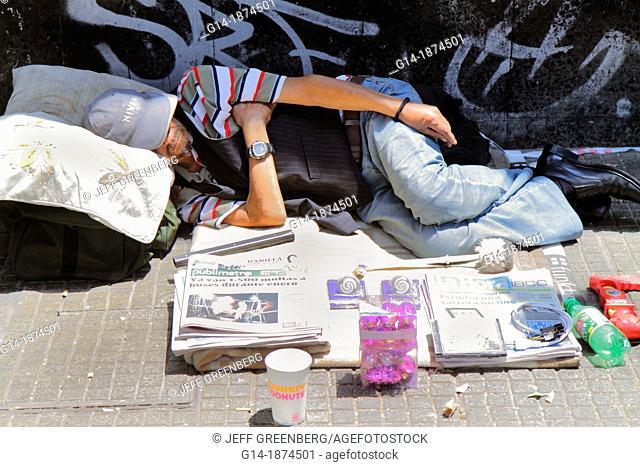 Chile, Santiago, Providencia, Avenida Libertador Bernardo O'Higgins, sidewalk, Hispanic, man, homeless, sleeping on street, newspaper