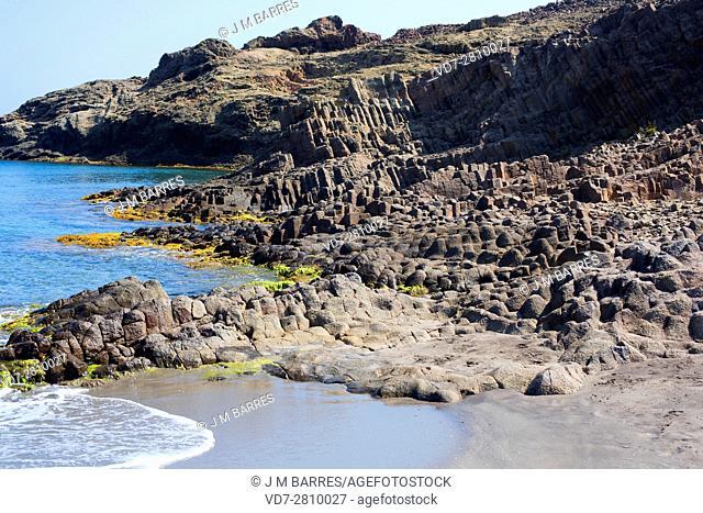 Columnar dacite. Dacite is an extrusive or volcanic rock. This photo was taken in Punta Baja, Cabo de Gata, Almeria, Andalusia, Spain