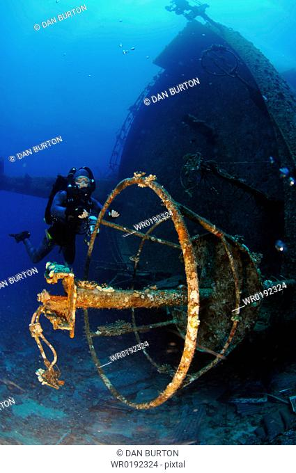 Mixed gas rebreather diver by crows nest of wrecked ship on seabed Red Sea