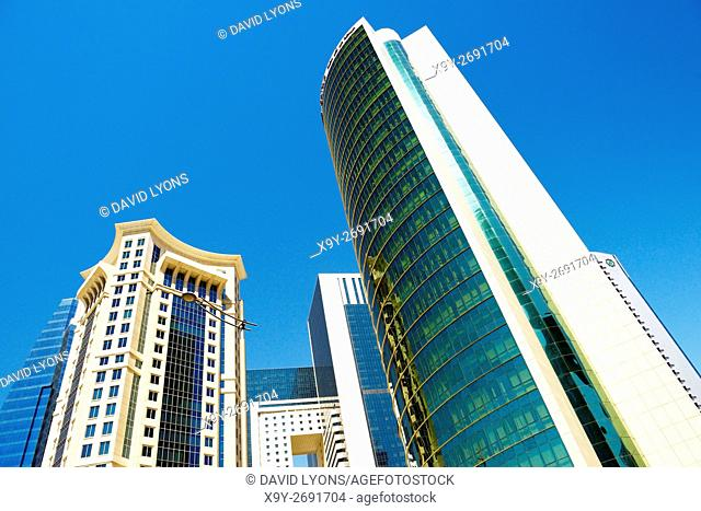 City centre West Bay area of Doha, Qatar. Majlis Al Taawon Street. Left is Burj Al Qassar Tower right is Olympic Committee Tower